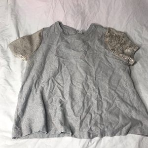 Gray sequins changing shirt